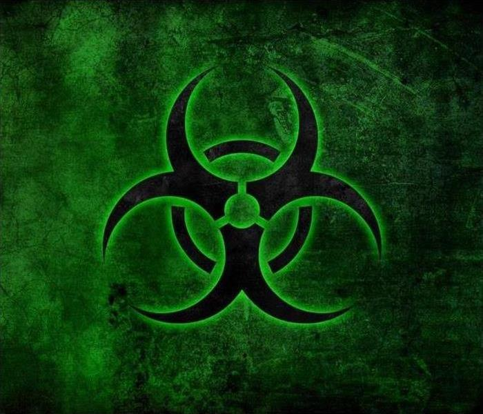 biohazard symbol in green on a black background